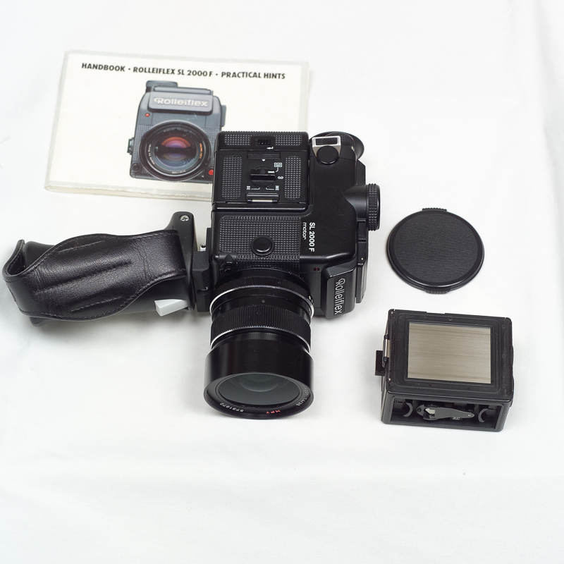 (Sold) Rolleiflex SL 2000F with 50mm f1.8 Planar HFT, extra magazine, pistol grip